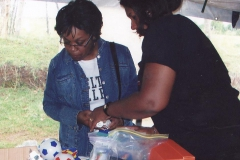 Sorors Holoman and Peters distributing donations 001